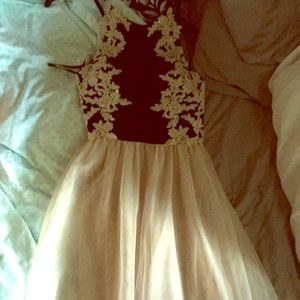 Black and cream colored long formal dress
